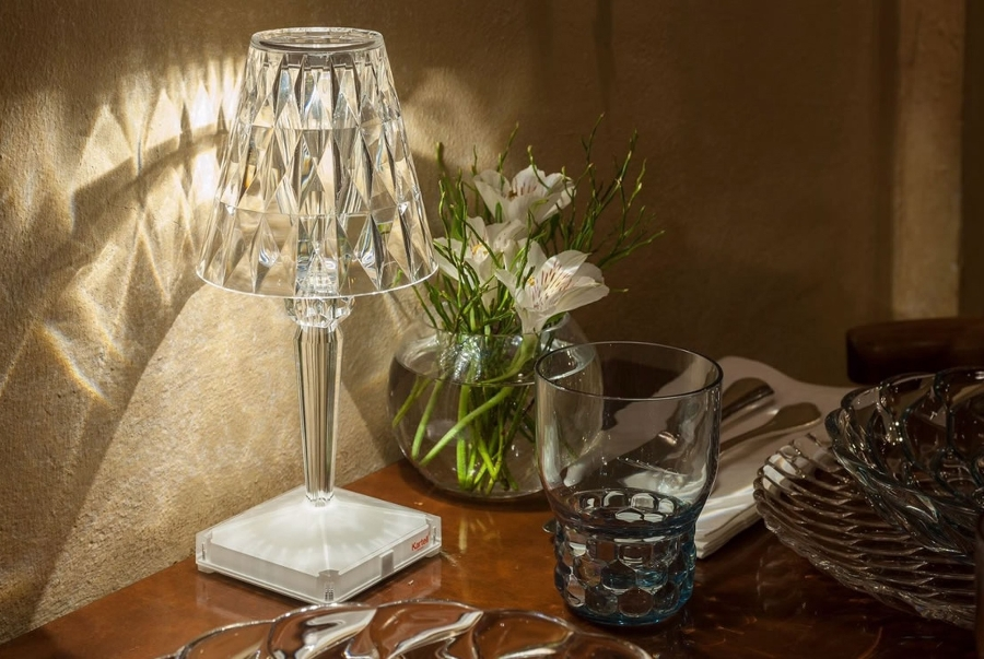 Battery lamp by kartell table